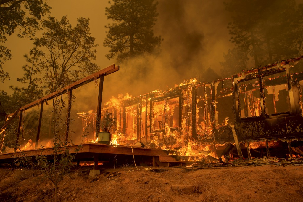 A home burns as the Butte Fire rages near Mountain Ranch, California September 11, 2015. The so-called Butte Fire has destroyed six homes and two outbuildings since it erupted on Wednesday near the former gold mining town of Jackson. Governor Jerry Brown on Friday declared a state of emergency for Amador and Calaveras counties, which were damaged by the blaze.  REUTERS/Noah Berger - RTSQ20