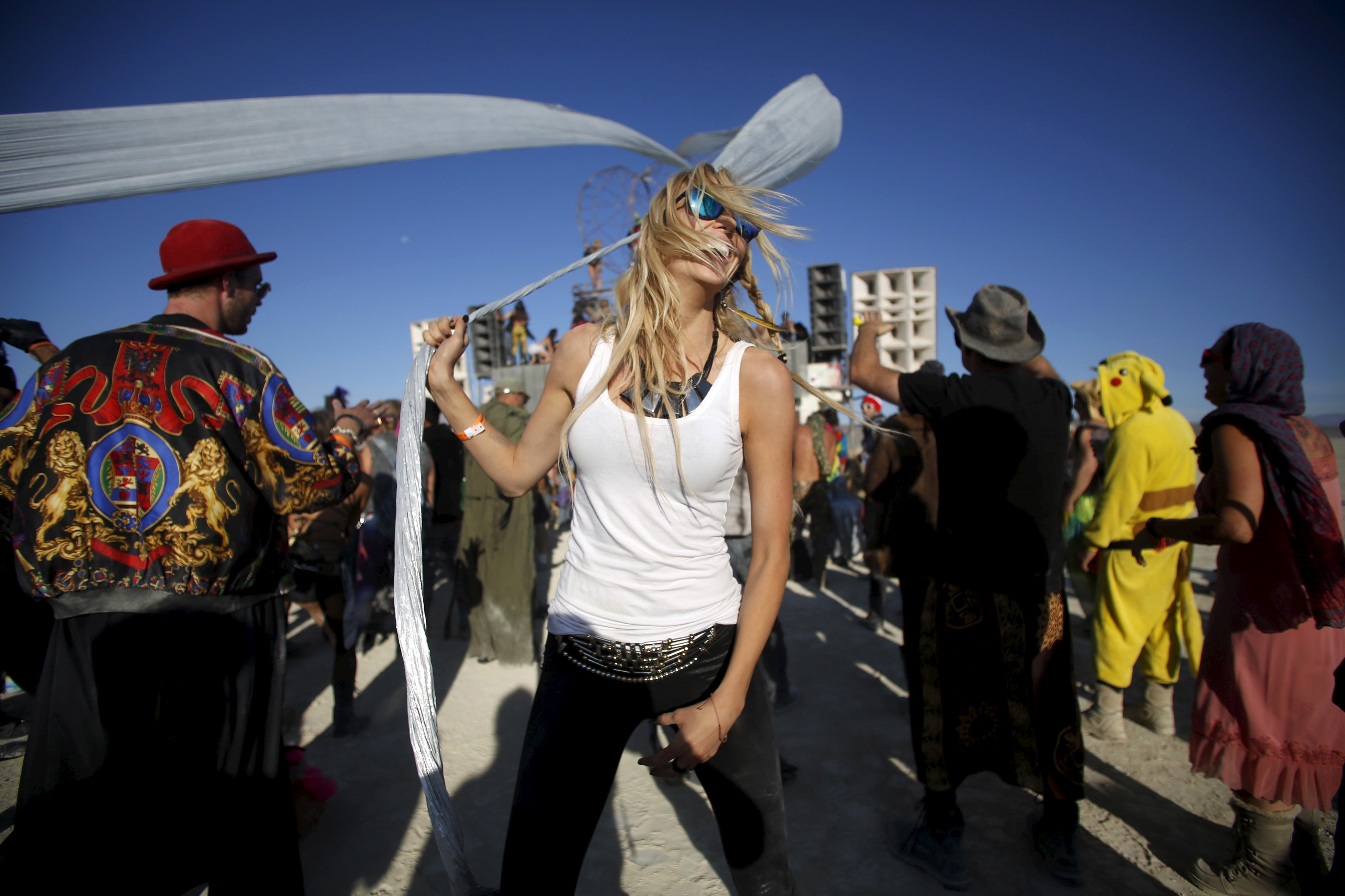 Burning Man started in San Francisco's Baker Beach in 1986 and then transitioned to Black Rock Desert in 1990. It's an art and music mishmash that encourages self-expression. Photo by Jim Urquhart/Reuters