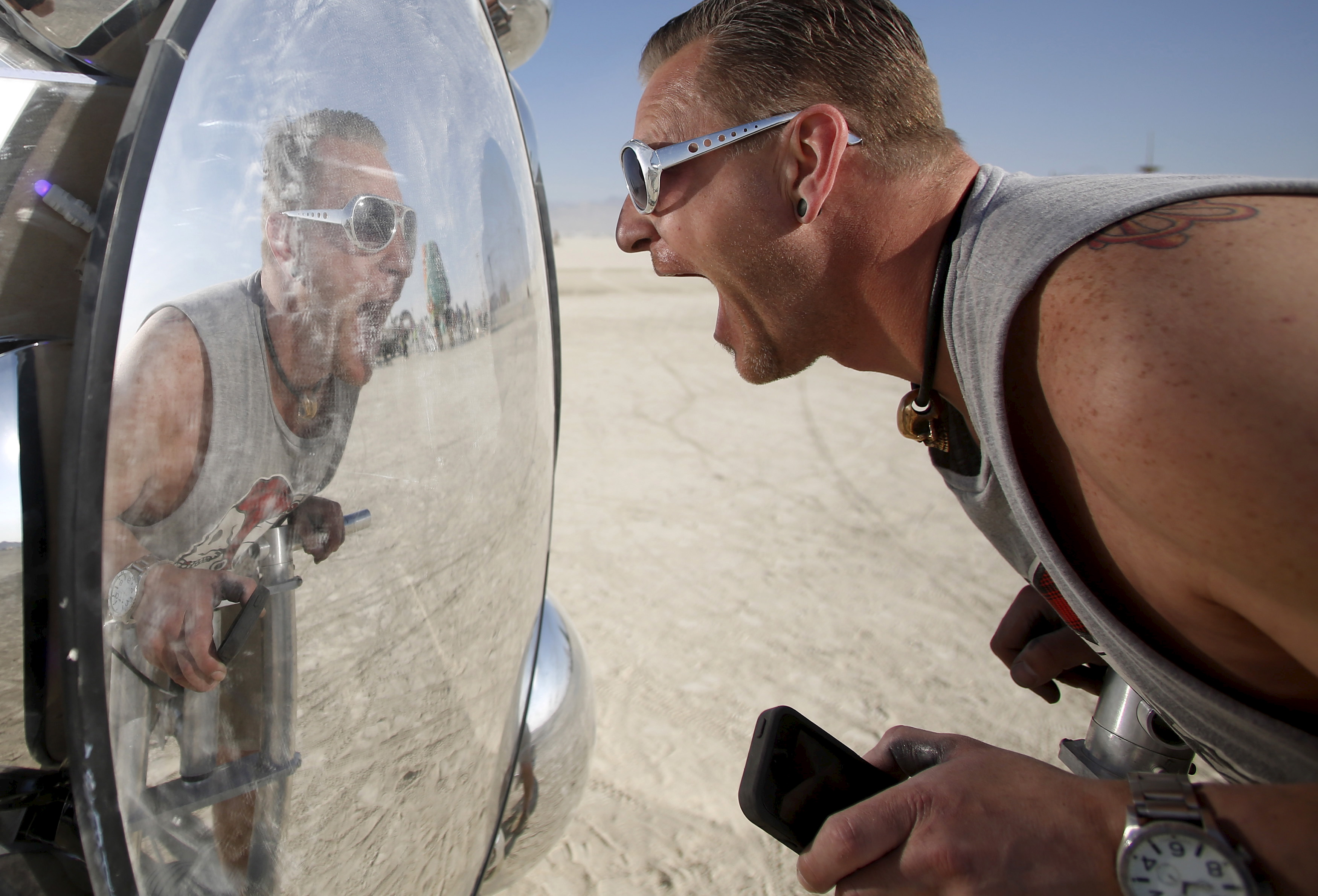 Wilf Griese interacts with the art installation Compound Eye during the desert fest on Sept. 1. Photo by Jim Urquhart/Reuters
