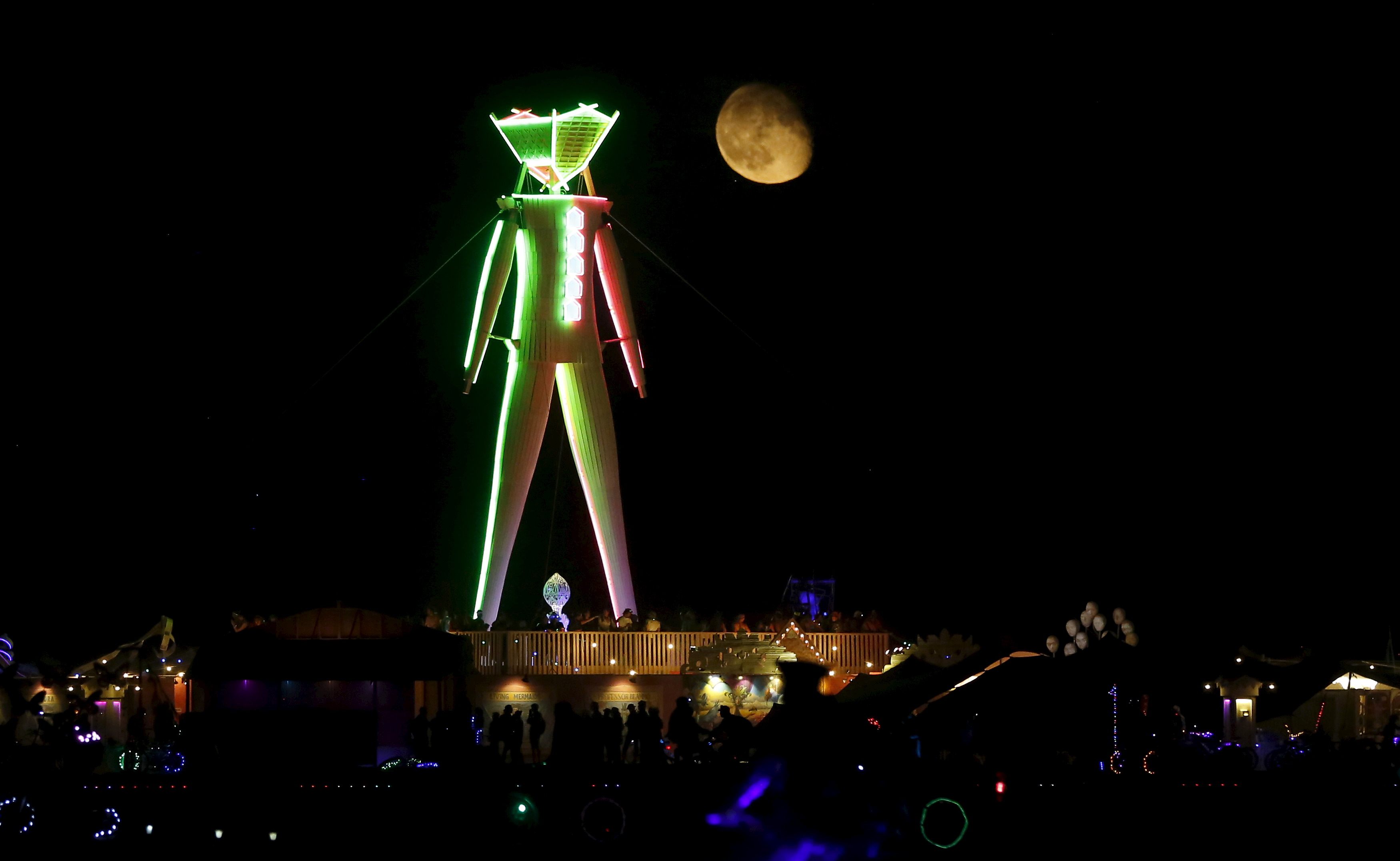 The moon rises behind the effigy that will be lit ablaze at the culmination of the Burning Man festival, which celebrates music, art and community. Photo by Jim Urquhart/Reuters