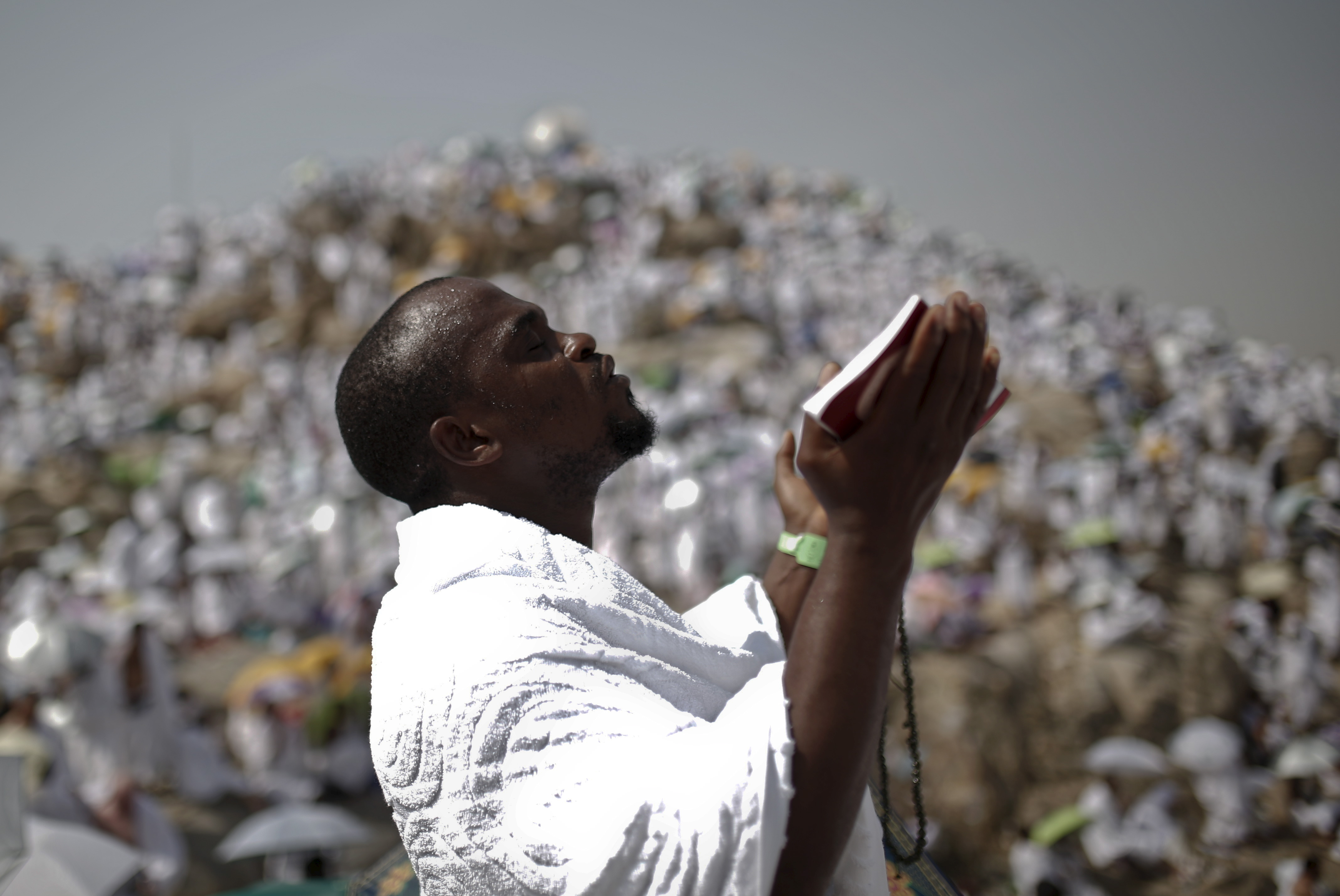 A Muslim pilgrim prays on Mount Mercy on the plains of Arafat in Saudi Arabia during the annual hajj pilgrimage, outside the holy city of Mecca on Sept. 23. Photo by Ahmad Masood/Reuters
