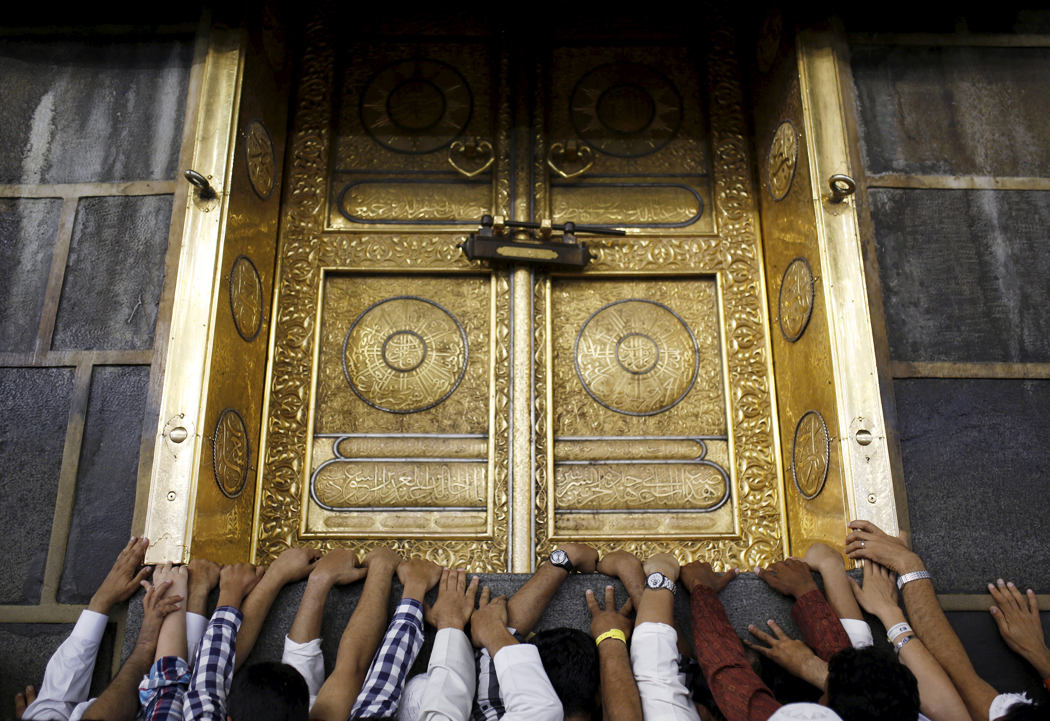 Muslim pilgrims touch the holy Kaaba at the Grand Mosque on the first day of Eid al-Adha during the annual hajj pilgrimage in Mecca, Saudi Arabia, on Sept. 24. Photo by Ahmad Masood/Reuters