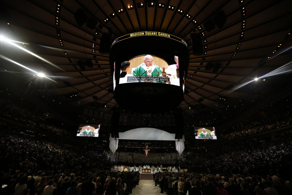 Pope Francis is shown on several large screens as he celebrates Mass at Madison Square Garden in New York on Sept. 25. Photo by Carlo Allegri/Reuters