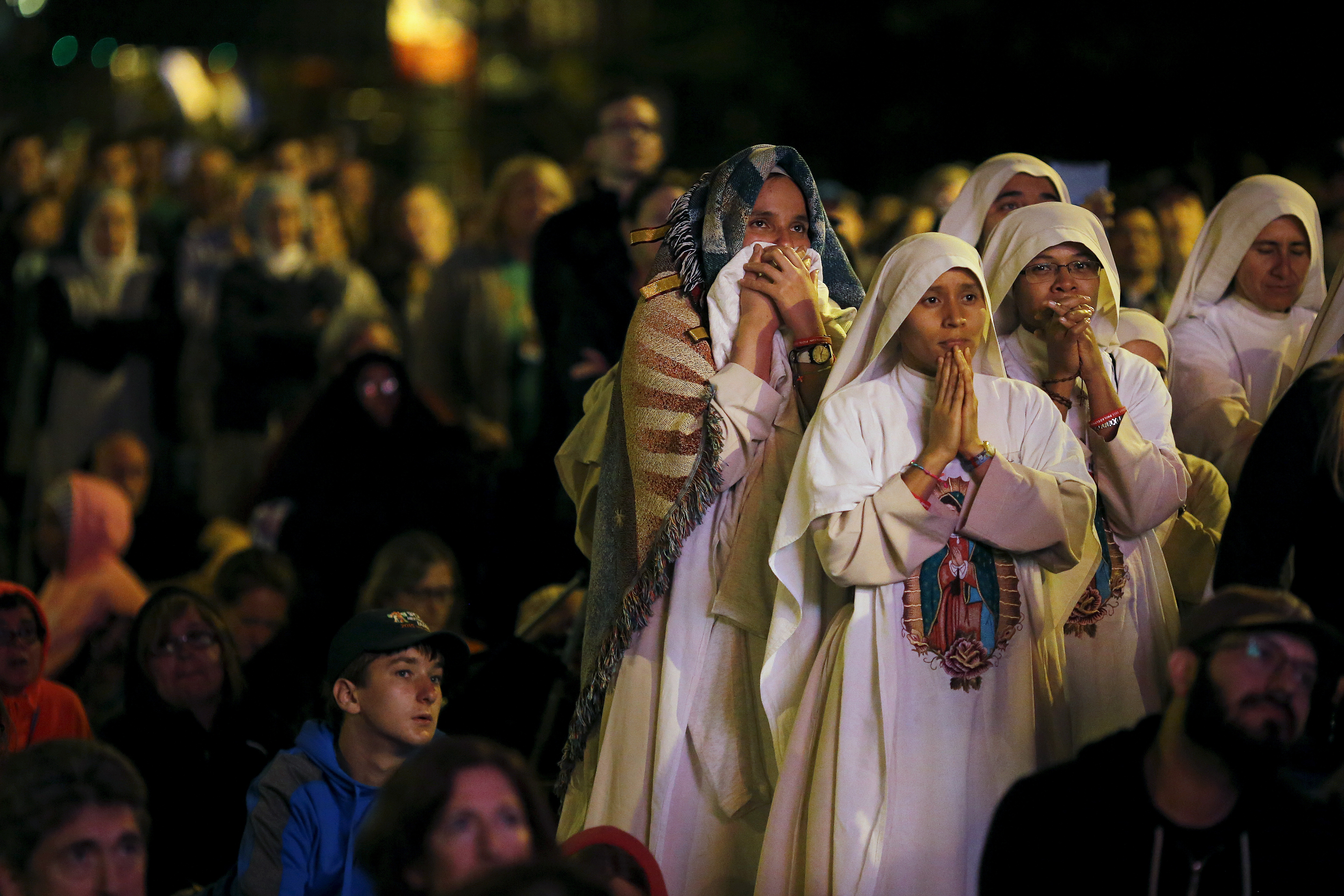 Nuns watch Pope Francis' speech Sept. 27 on a screen during the Festival of Families rally Philadelphia. Credit: Carlos Barria/ Reuters