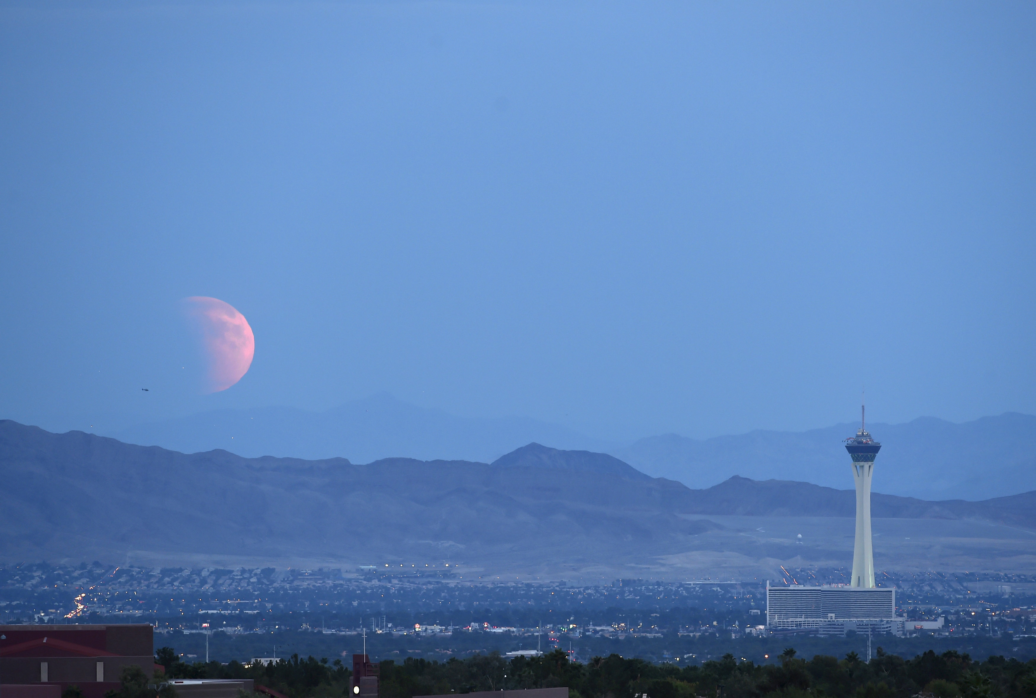 A partially eclipsed supermoon rises over Las Vegas, Nevada, on Sept. 27. Photo by David Becker/Reuters