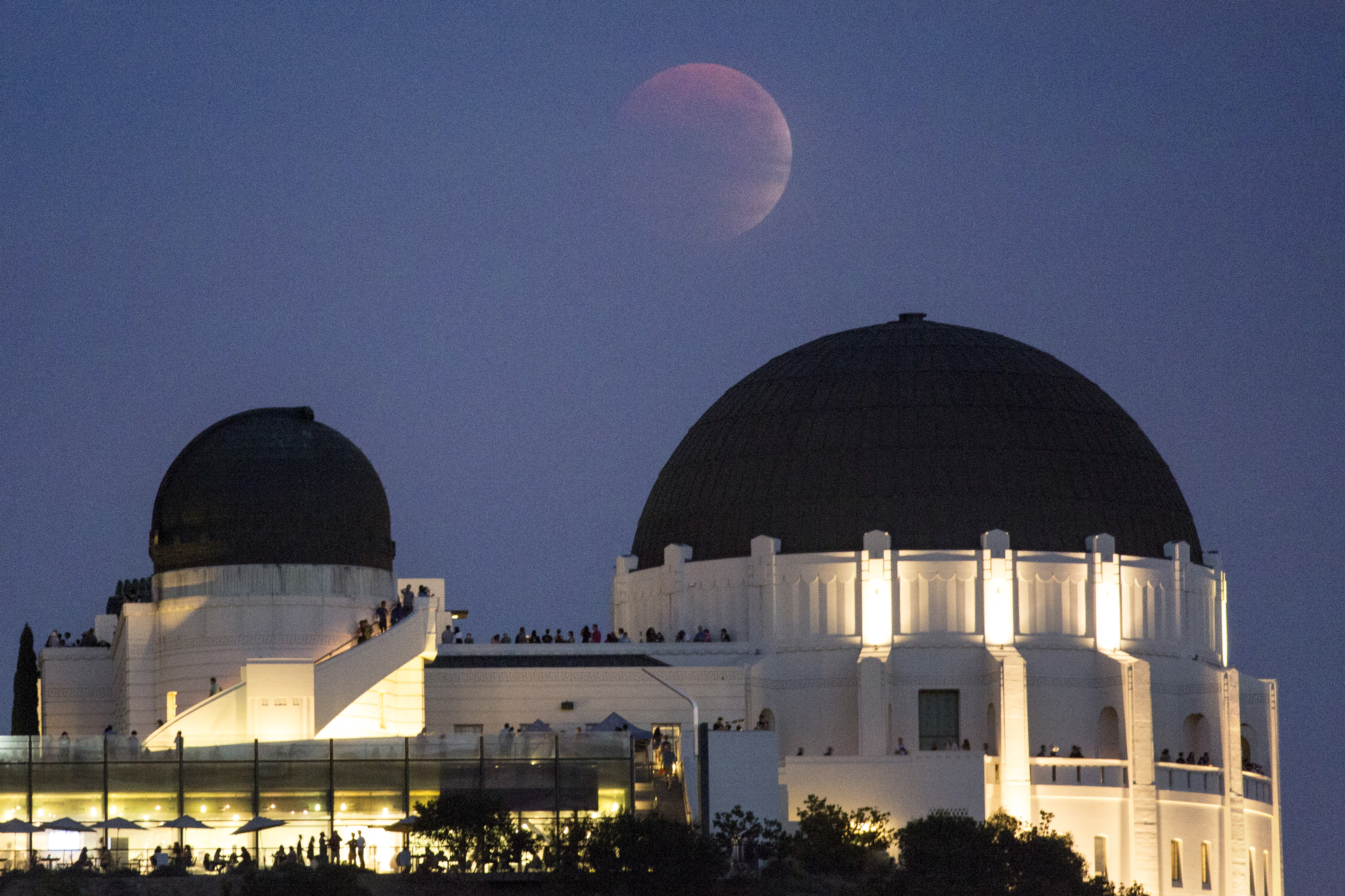 A supermoon is seen in the sky above Griffith Park Observatory in Los Angeles, California on Sept. 27. The next total lunar eclipse is January 2018. Photo by Jonathan Alcorn/Reuters