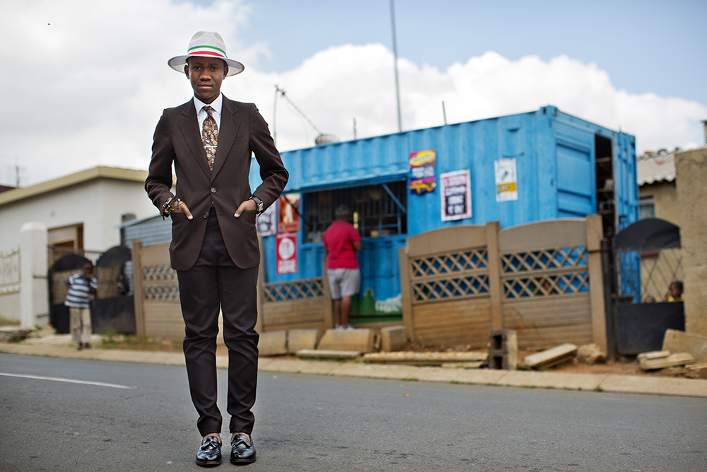 """Schuman took this photo in Soweto, South Africa. This man's style connoted that he """"was trying to figure out how to fit into that outside world while he still lived in his place,"""" he said. """"That's something I like to try to capture, because it's not ever just the clothes. None of the photographs are ever just about the clothes."""" Photo by Scott Schuman"""