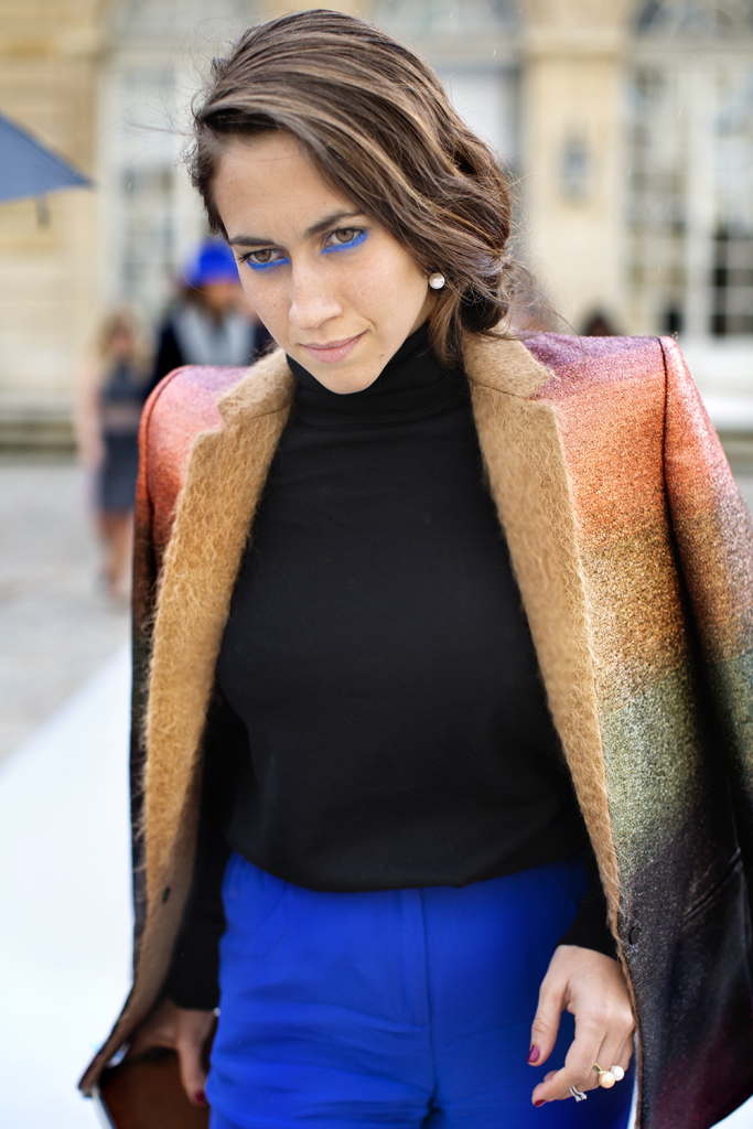 """""""I've known Delfina Delettrez for a few years. She's a jewelry designer in her own right who also happens to belong to the Fendi family. She's made a name for herself creatively but also as one of the next generation style stars. There's not many people I'm curious to see what they're wearing each time I see them, but she's one of them. She doesn't let the weight of generations of good taste that comes with her family name, stop her from taking chances. She literally caught my eye with this blue eyeliner that you can't not notice."""" Photo by Scott Schuman"""