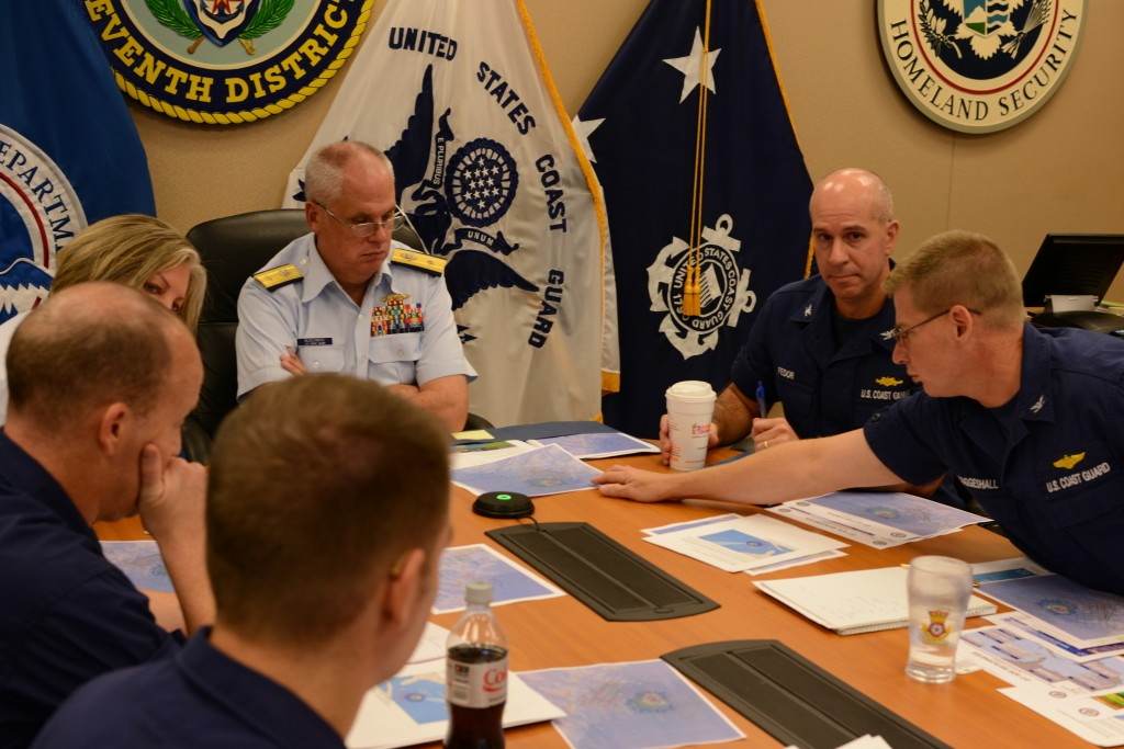 Rear Adm. Scott Buschman, commander of the Coast Guard 7th District, receives an update brief for the missing cargo ship El Faro at the Coast Guard 7th District in Miami Oct. 3, 2015. Coast Guard search crews have covered more than 850 square nautical miles in the search for the El Faro crew. (Coast Guard photo by Petty Officer 2nd Class Jon-Paul Rios)