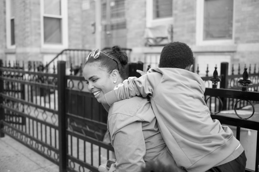 "Evelyn with the son of her domestic partner in Long Island City, New York City. ""I met my partner when I'd only been home for a few days. She has three kids and me not having kids, I became close to the kids and that was an extra."" Photo and caption by Sara Bennett"