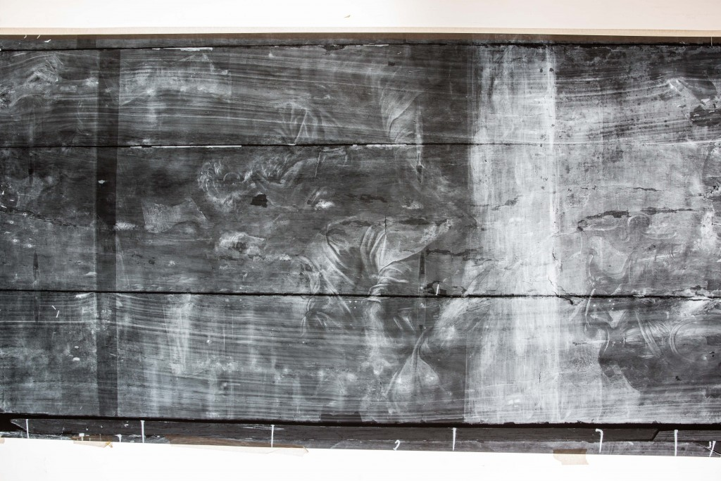 "A large x-ray shows one panel of Giorgio Vasari's ""Last Supper,"" including where the splits in its wood planks occurred and where paint was lost. Photo by Frank Carlson"