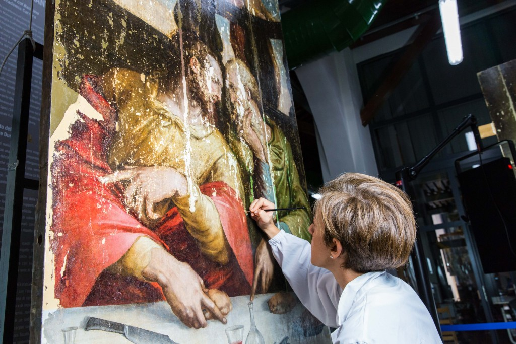 "A conservator works on a panel of Giorgio Vasari's ""Last Supper,"" which the Opificio delle Pietre Dure is now restoring, nearly 50 years after it was damaged by a flood. Photo by Frank Carlson"