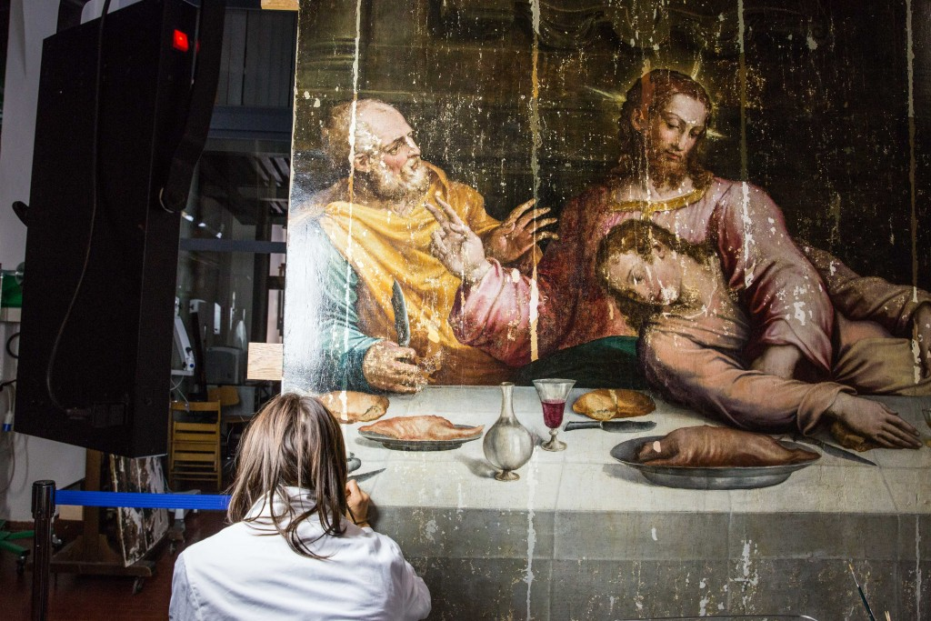 "Another restorer works on the central panel of Vasari's ""Last Supper."" The painting sat in storage for more than 40 years after the 1966 flood while experts developed the skills and confidence to restore it in one piece. Photo by Frank Carlson"