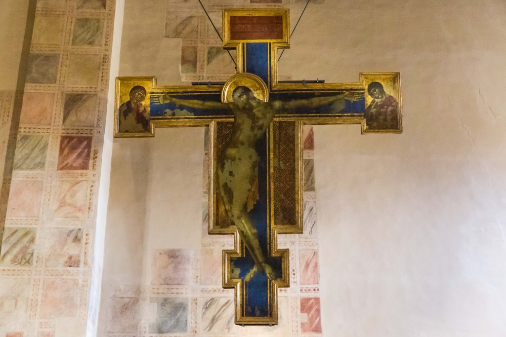 "The Crucifix by Cimabue hangs in the Santa Croce Church museum in Florence, Italy, just a few blocks from the Arno River. During the 1966 flood it was badly damaged, becoming a symbol of the flood. Another painting that hung in the Santa Croce was Giorgio Vasari's ""Last Supper,"" now undergoing restoration. Photo by Frank Carlson"