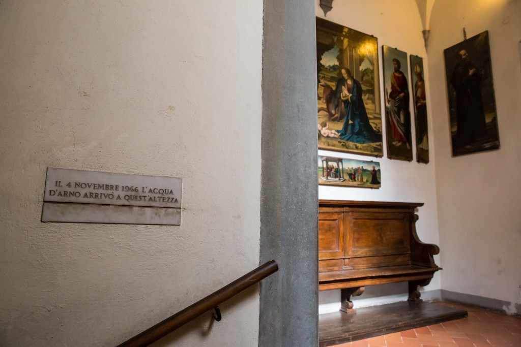 A sign on the second floor of the Santa Croce museum shows how high the water rose during the 1966 flood. Signposts like these can be found around Florence today. Photo by Frank Carlson
