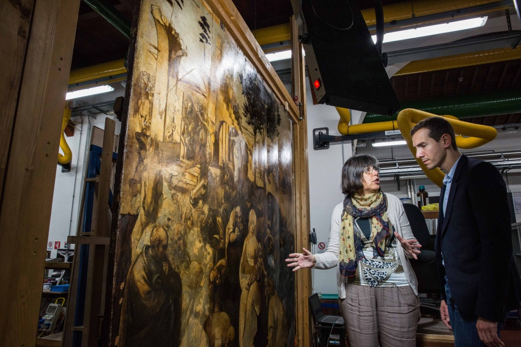 "Cecilia Frosinini, deputy director of the Opificio delle Pietre Dure, explains the restoration work that's been done on Leonardo da Vinci's ""Adoration of the Magi,"" which arrived in November 2011 from the Uffizi Gallery in Florence and is now being cleaned. Photo by Frank Carlson"