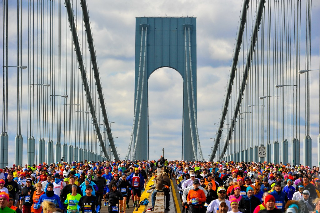NEW YORK, NY - NOVEMBER 02: Runners cross the Verrazano-Narrows Bridge at the start of the TCS New York City Marathon on November 2, 2014 in the Brooklyn borough of New York City. (Photo by Alex Goodlett/Getty Images)