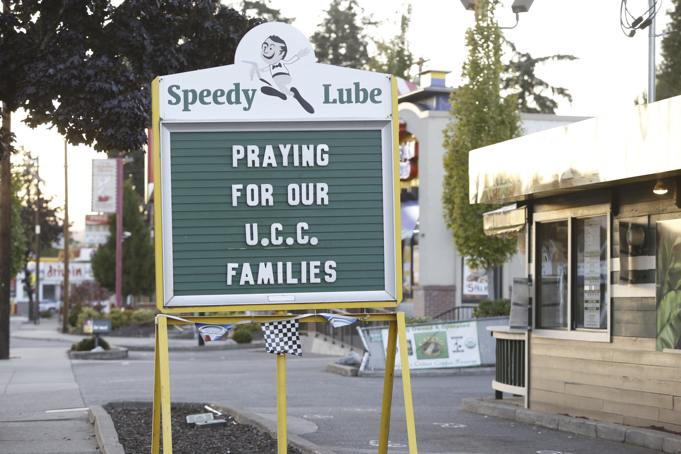 A sign expresses local people's sentiments following Thursday's UCC shooting. Photo by Steve Dipaola/Reuters