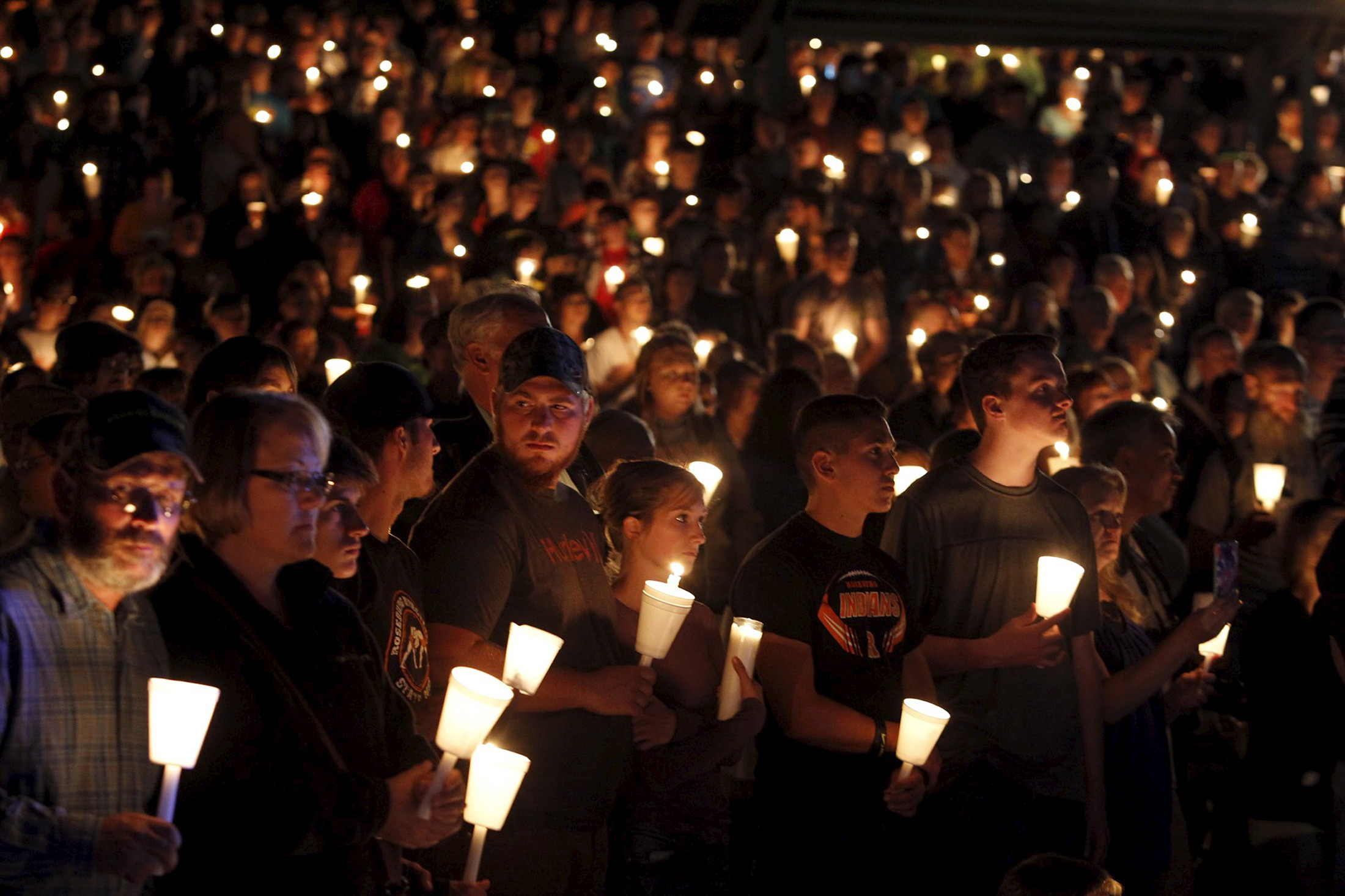 People take part in candlelight vigil following Thursday's mass shooting at Umpqua Community College in Roseburg, Ore. Photo by Steve Dipaola/Reuters