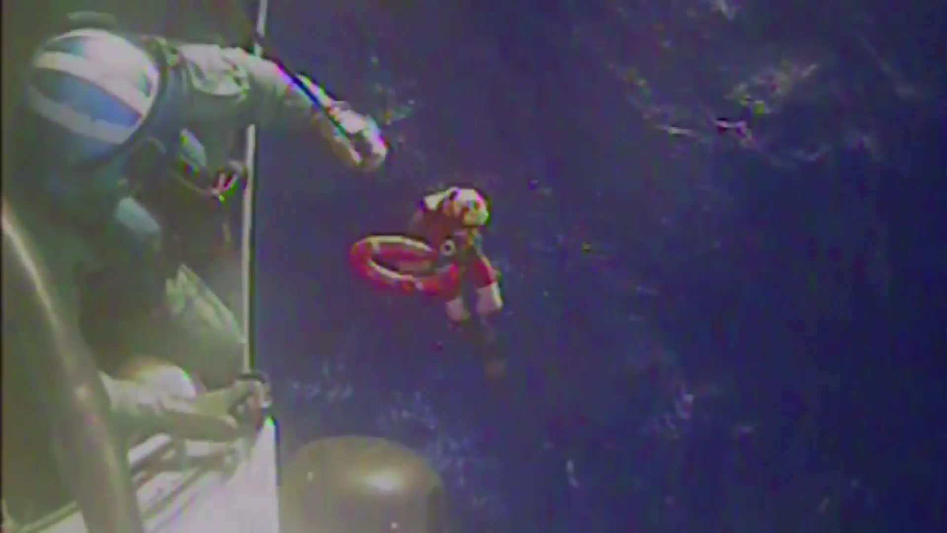 U.S. Coast Guard members retrieve a life preserver ring from the cargo ship El Faro in this still image from a Oct. 4, 2015 U.S. Coast Guard handout video. Image courtesy of U.S. Coast Guard/Handout via Reuters