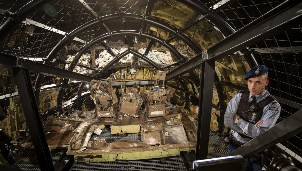 A military policeman stands guard in the cockpit of the reconstructed MH17 airplane. Photo by Michael Kooren/Reuters