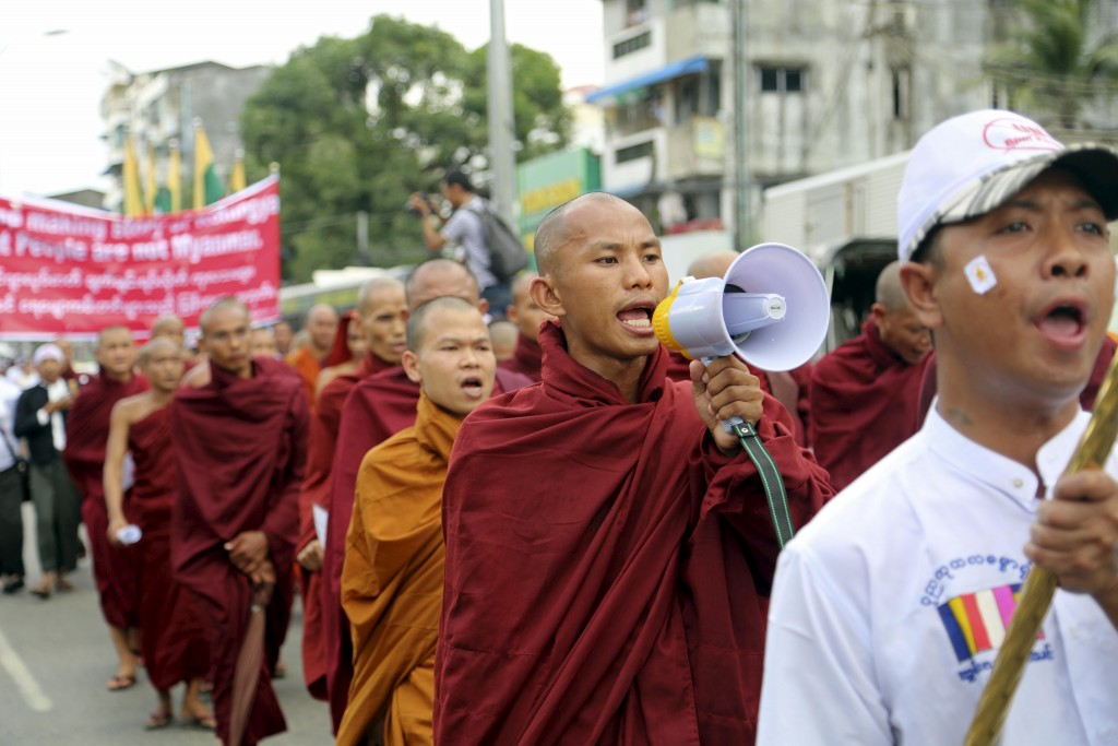 Monks and protesters shout during a march to denounce foreign criticism of the country's treatment of stateless Rohingya Muslims, in Yangon, Myanmar May 27, 2015. Photo by Aubrey Belford/Reuters