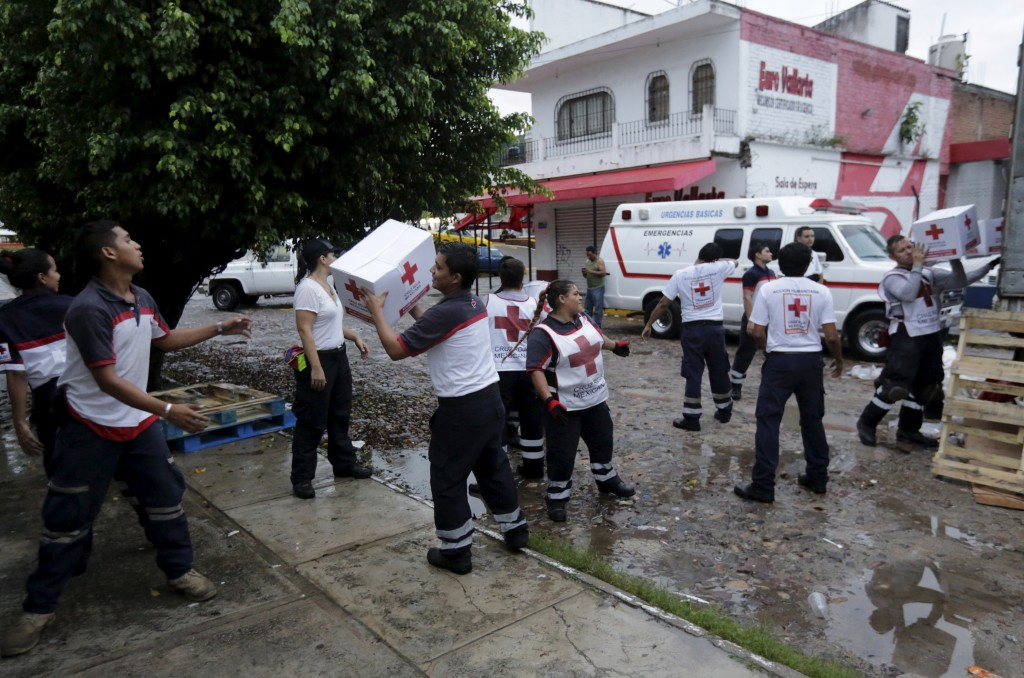 Red Cross volunteers load humanitarian aid boxes from a truck in the Pacific beach resort of Puerto Vallarta, Mexico October 24, 2015. Photo by Henry Romero/Reuters.