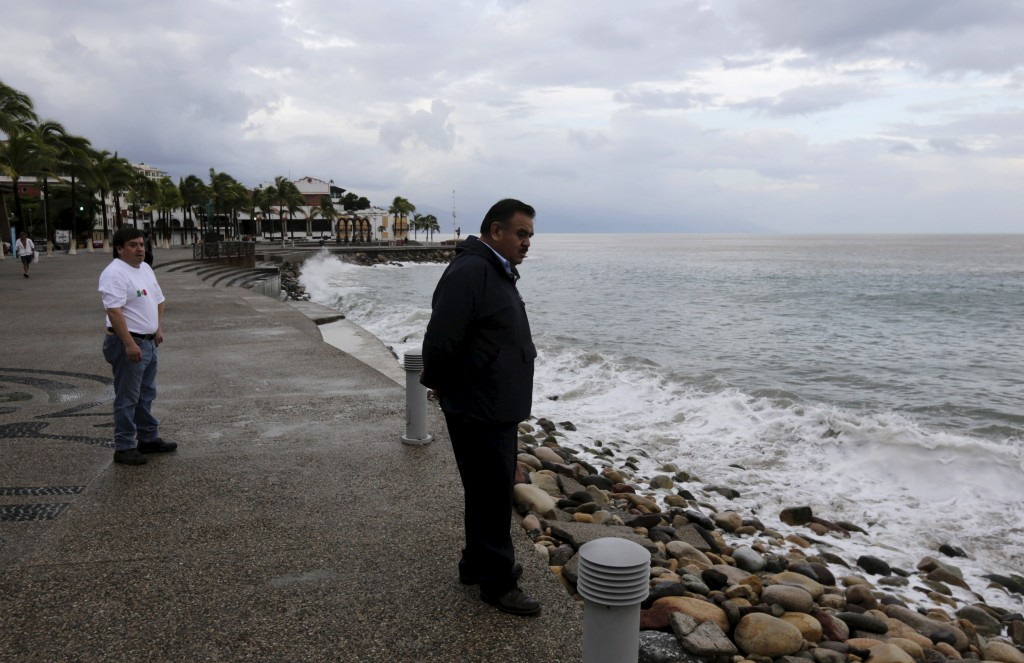 A man gazes out to the bay just off the city's historic boardwalk in the Pacific beach resort of Puerto Vallarta, Mexico October 24, 2015. Photo by Henry Romero/Reuters.