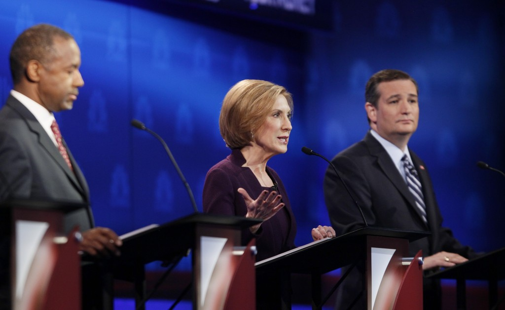 Republican U.S. presidential candidate former HP CEO Carly Fiorina speaks as Dr. Ben Carson, left, and U.S. Senator Ted Cruz listen at the 2016 U.S. Republican presidential candidates debate held by CNBC in Boulder, Colorado, Wednesday. Photo by Rick Wilking/Reuters