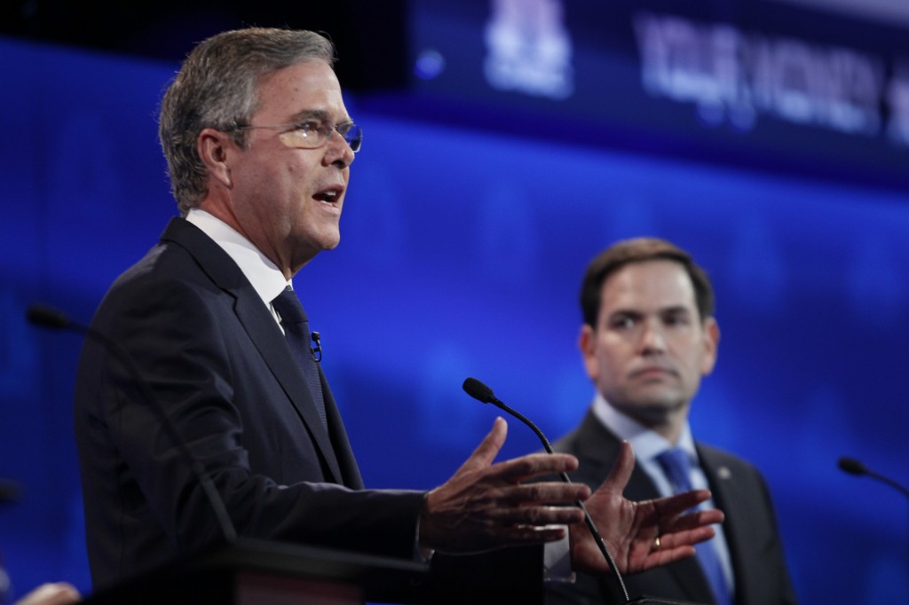 Republican U.S. presidential candidate former Governor Jeb Bush speaks as U.S. Senator Marco Rubio, right, looks on at the 2016 U.S. Republican presidential candidates debate. Photo by Rick Wilking/Reuters
