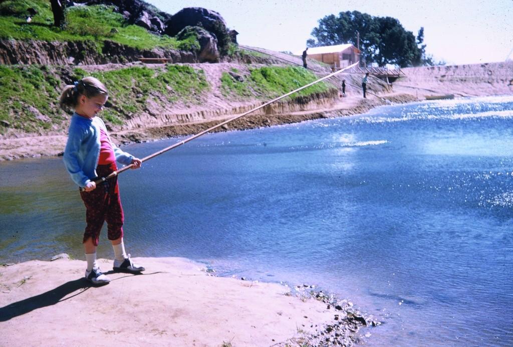 A young Sally Ride  fishing at Lake Gregory in the San Bernardino Mountains, California in 1957. Courtesy of Tam O'Shaughnessy/Ride Family/MacMillan Children's Publishing Group
