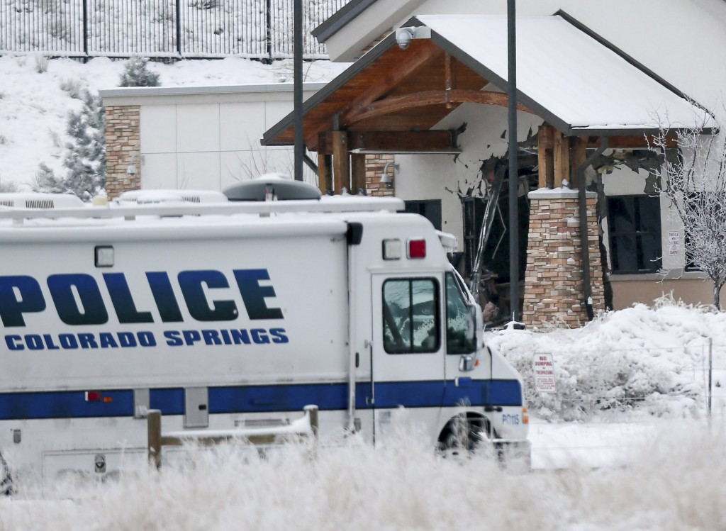 A police vehicle is seen parked outside the Planned Parenthood clinic on Saturday, a day after a gunman opened fire in Colorado Springs, Colorado. Police identified the gunman as Robert Lewis Dear. Federal authorities are deciding whether to categorize the shootings as a hate crime. Reuters/Isaiah J. Downing