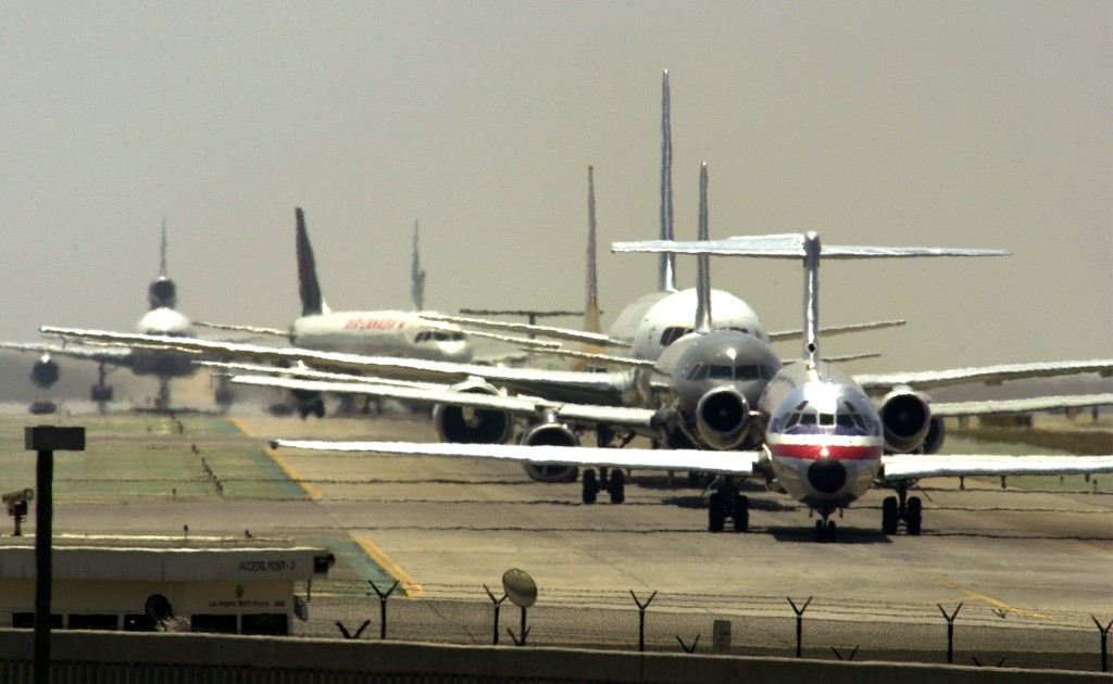 Airliners line up for take off at Los Angeles International Airport June 20, 2001 in Los Angeles, California. Photo by David McNew/via Getty Images