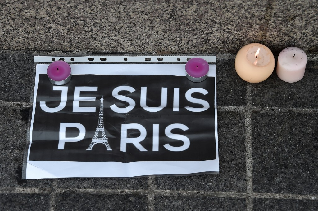 This photo taken on November 14, 2015 in Strasbourg, eastern France, shows a memorial of flowers and candles following a series of terrorist attacks resulting in the death of at least 120 people in Paris on November 13.Photo by Frederick Florin/AFP/Getty Images