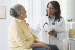 Older woman talking to doctor in office. Related words: Medicare, seniors, hospital, health insurance Photo by KidStock/Getty Images