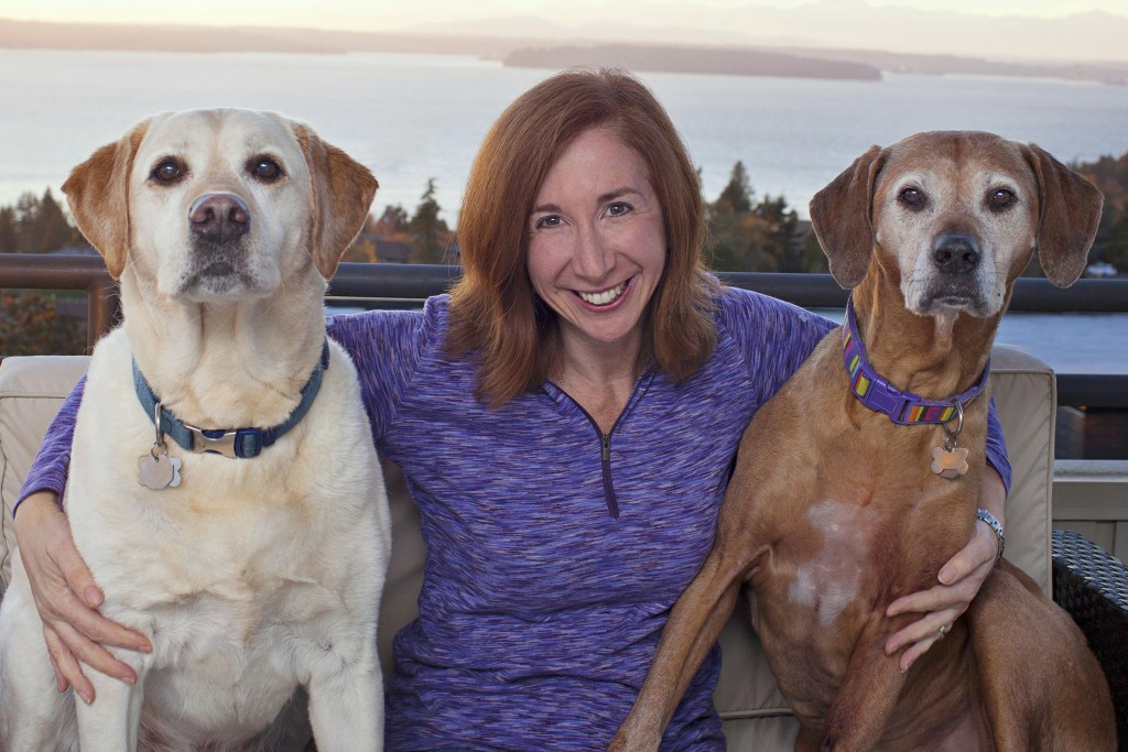 "Laura T. Coffey, author of the new book ""My Old Dog: Rescued Pets with Remarkable Second Acts,"" pictured with her two senior dogs, Manny (left) and Frida. Copyright Lori Fusaro/""My Old Dog"""