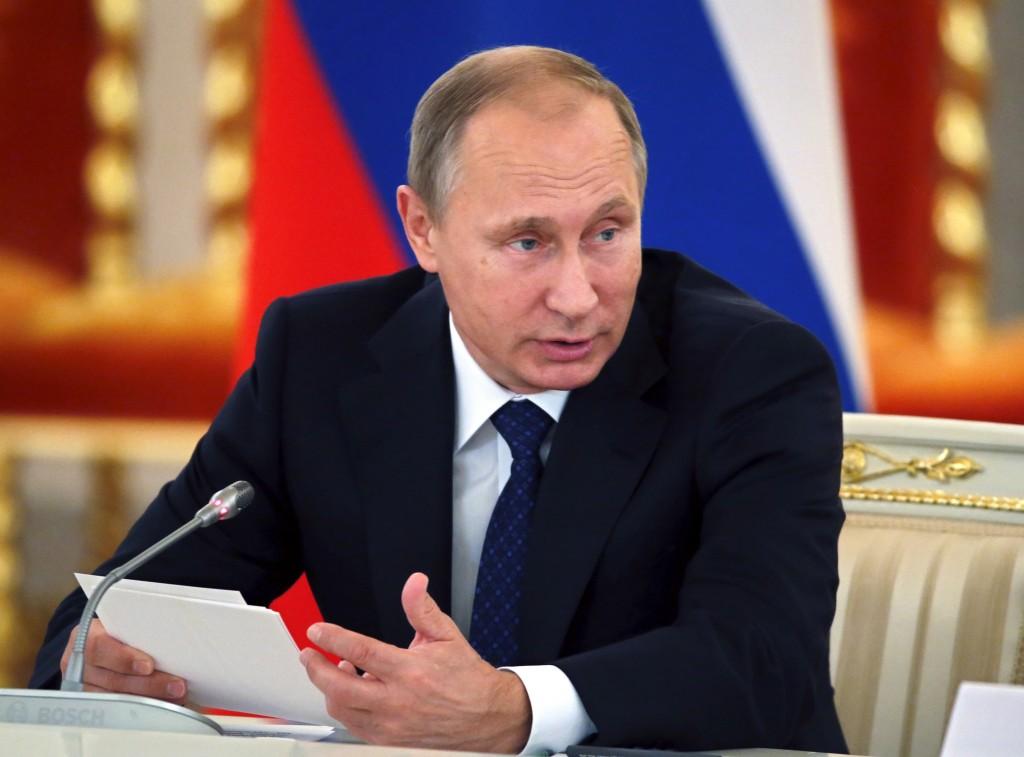 File photo of Russian President Vladimir Putin by Yuri Kochetkov/Pool via Reuters
