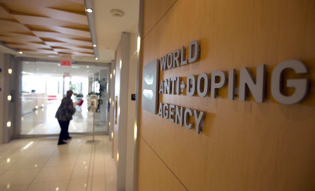 A woman walks into the head office for the World Anti-Doping Agency (WADA) in Montreal, November 9, 2015. An international...