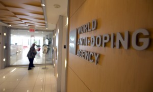 A woman walks into the head office for the World Anti-Doping Agency (WADA) in Montreal, November 9, 2015. An international anti-doping commission recommended on Monday that Russia's Athletics Federation be banned from international competition over widespread doping offences - a move that could see the powerhouse Russian team excluded from next year's Rio Olympics. Russian sports minister said there was no evidence for the accusations against the Federation. Photo by Christinne Muschi/Reuters