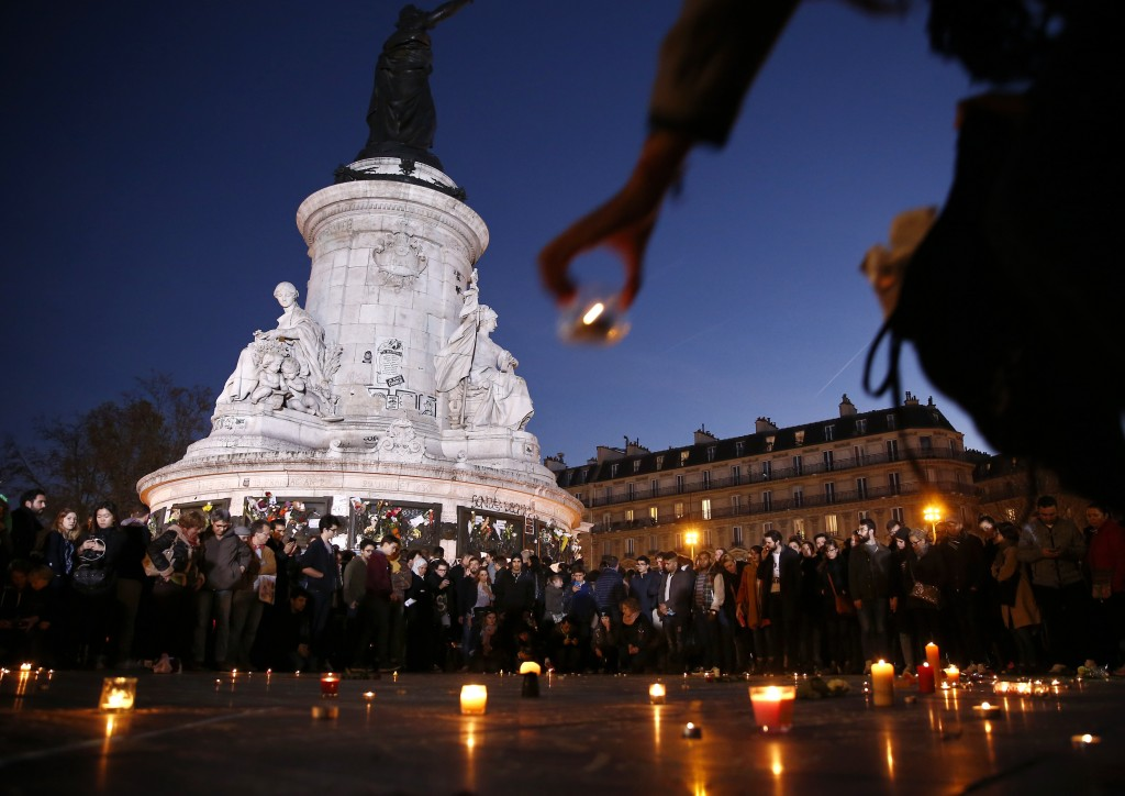 A candle is placed during a vigil in Place de la Republique following the series of deadly attacks in Paris, November 15, 2015.  Photo by Benoit Tessier /Reuters