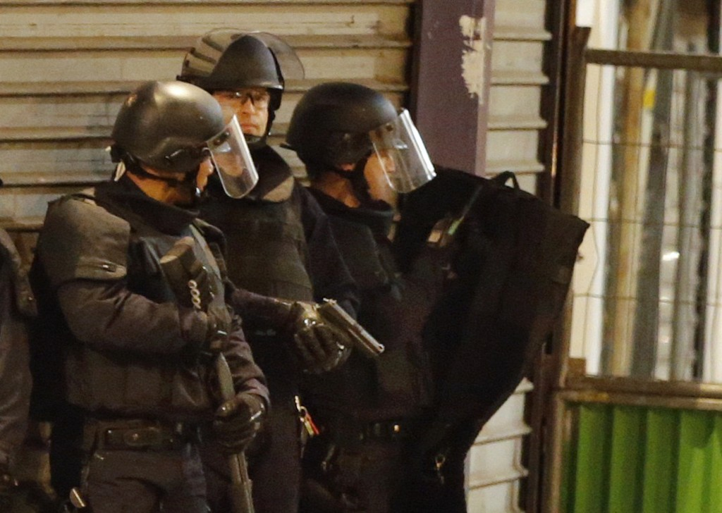 French special police forces secure the area as shots are exchanged in Saint-Denis, France, near Paris, November 18, 2015 during an operation to catch fugitives from Friday night's deadly attacks in the French capital. Photo by Christian Hartmann/Reuters