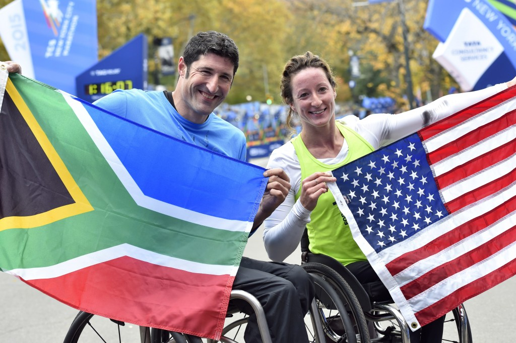 Nov 1, 2015; New York, NY, USA; Ernst Van Dyk (left) and Tatyana McFadden celebrate after winning their devisions of the Push Rim Wheelchair Race during the 2015 TCS New York City Marathon. Mandatory Credit: Derik Hamilton-USA TODAY Sports - RTX1U9E4