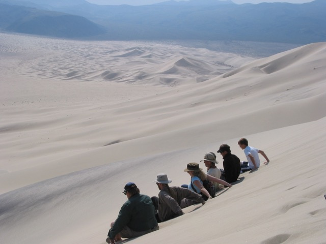 Sliding down on the seat of your pants and creating a large sand avalanche on the  656-foot-high Eureka Dune in Death Valley National Park, Calif.  Photo by Nathalie Vriend