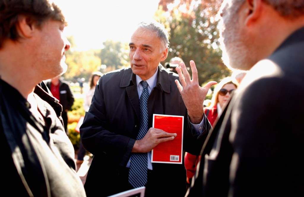 Nader talks with labor leaders before addressing hundreds of members of National Nurses United and their supporters during a rally in Laffayette Square across from the White House before marching to the U.S. Treasury Department November 3, 2011 in Washington, DC. Photo by Chip Somodevilla/Getty Images.