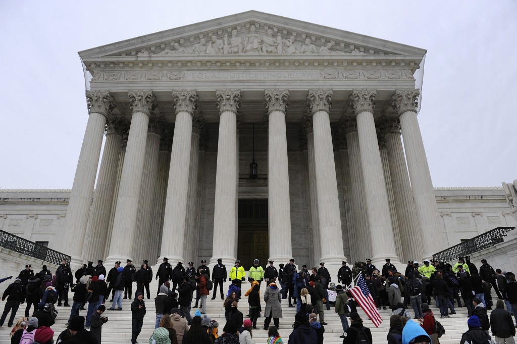 Police form a line after arresting demonstrators on the steps of the U.S. Supreme Court building, on the 2012 anniversary ...