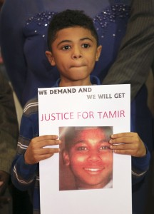 A boy holds a sign in support as Samaria Rice, the mother of Tamir Rice, the 12-year old boy who was fatally shot by police last year while carrying what turned out to be a replica toy gun, speaks during a news conference at the Olivet Baptist Church in Cleveland, Ohio in 2014. An expert this week said the officer who shot Rice would not have seen the gun. Photo by Aaron Josefczyk/Reuters