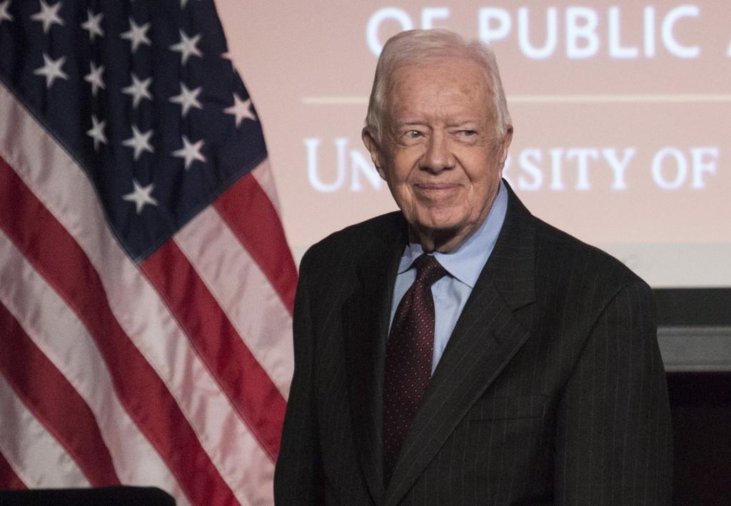 Former U.S. President Jimmy Carter arrives to speak during an event honoring former U.S. Vice President Walter Mondale hos...
