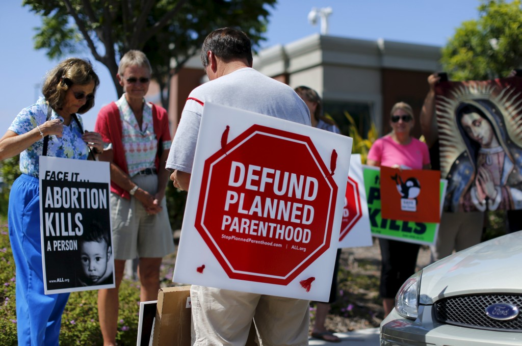 Protesters gather outside a Planned Parenthood clinic in Vista, California in 2015. Photo by      REUTERS/Mike Blake.