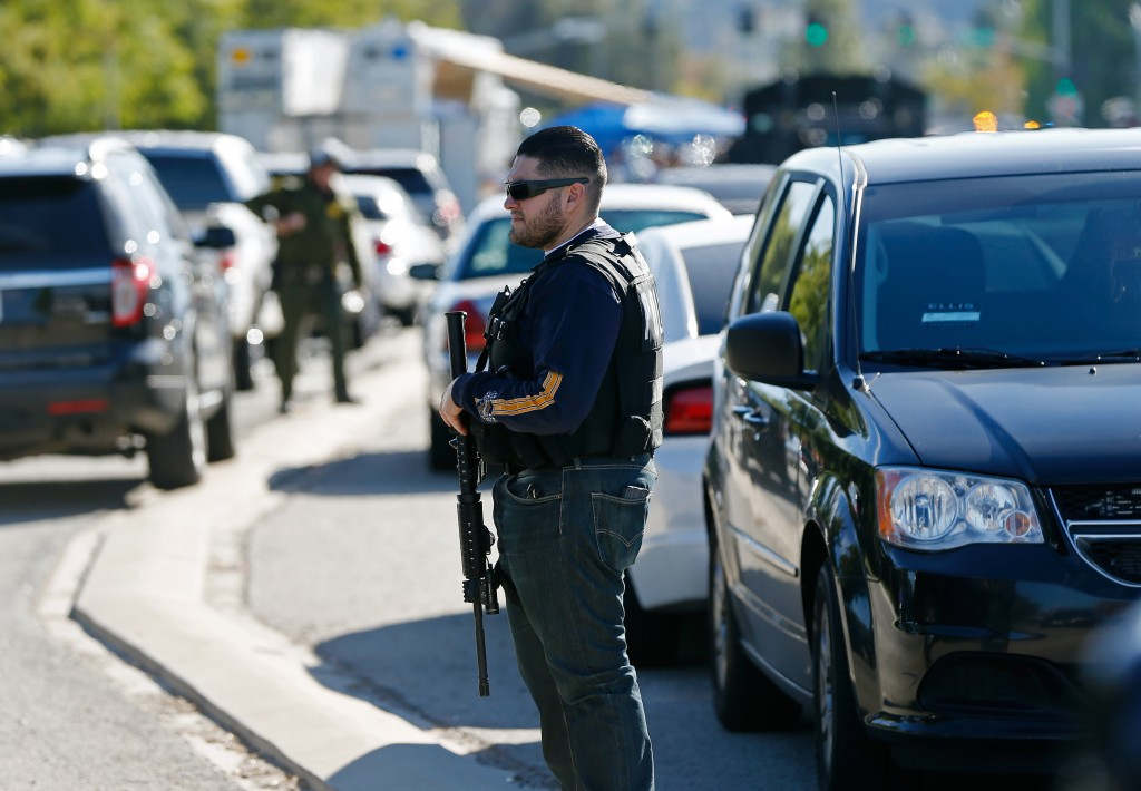 Police officers secure the area after a shooting at a social services agency in San Bernardino, California, Wednesday. Photo by Mario Anzuoni/Reuters