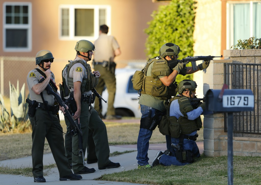 Police officers conduct a manhunt after a mass shooting that killed 14 and wounded 17 in San Bernardino, California, Wednesday. Photo by Mike Blake/Reuters